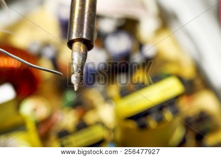 Melting Solder Wire On Soldering Iron Tip