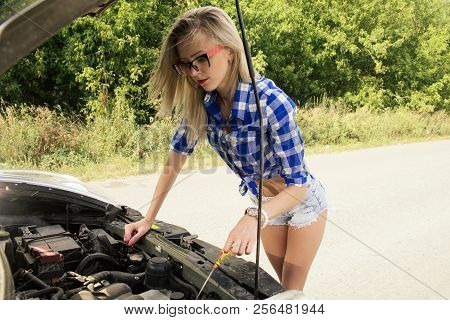 A Broken Car On The Road, The Sexy Girl Checks The Oil Level.