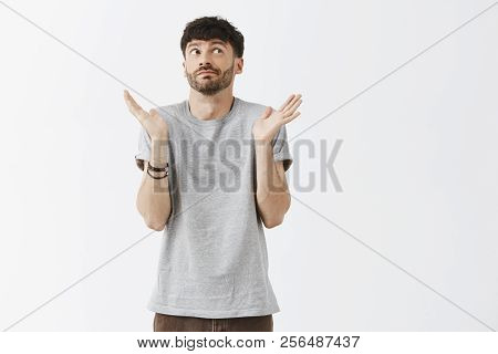 No Ideas. Portrait Of Struggling Unaware Attractive Bearded Man With Good Haircut Smirking And Shrug