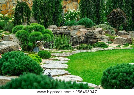 A Country House With A Beautiful Backyard Behind The House, Landscape Design