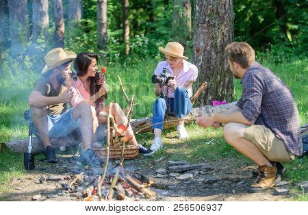 Company Having Hike Picnic Nature Background. Picnic With Friends In Forest Near Bonfire. Hikers Sha