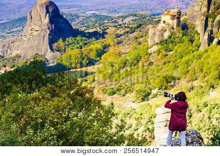 Tourism Vacation And Travel. Female Tourist Taking Photo With Camera From Mountains Cliffs Over Kala