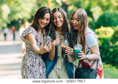 Summer Lifestyle Portrait Multiracial Women Enjoy Nice Day, Holding Glasses Of Milkshakes. Happy Fri