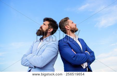 Sure Sign You Should Trust Business Partner. Men Formal Suits Stand Back To Back Blue Sky Background