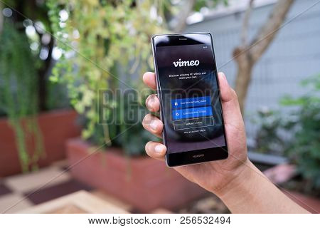 Chiang Mai, Thailand - August 05,2018: Man Hands Holding Huawei With Vimeo On Screen.  Vimeo Is A Vi