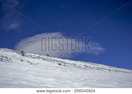 Elbrus Side With Stones And Lots Of Clouds
