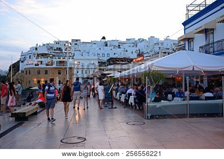 Albufeira, Portugal - June 12, 2017 - View Of The R Sao Goncalo De Lagos In The Evening With Tourist