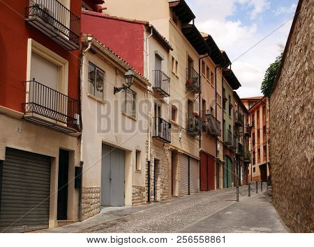 Old Buildings Located In The La Andaquilla Street In The Teruel, Spain, At Sunny Summer Day