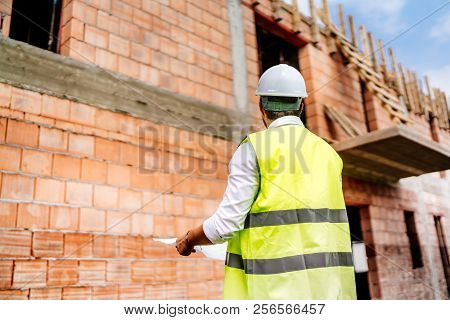 Construction Engineer On Construction Site Background, Man Wearing Safety Vest, Hard Top On Construc