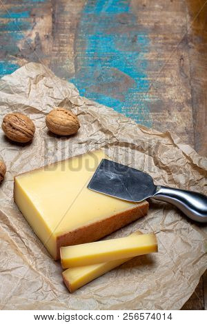 Piece Of Aged Comte Or Gruyere De Comte, Aoc French Cheese Made From Unpasteurized Cow's Milk In The
