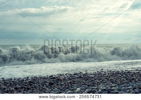An Uneasy Black Sea With Waves And Foam. View From The Shore, Tinting. Sea Waves With A Lot Of Sea F