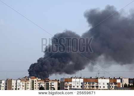 Images of smoke from a fire in the city.