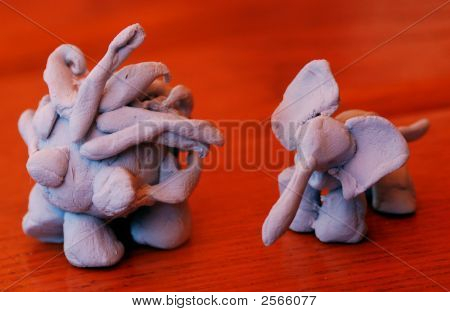 Tiny Clay Figures Of Porcupine Or Hegehog And Elephant