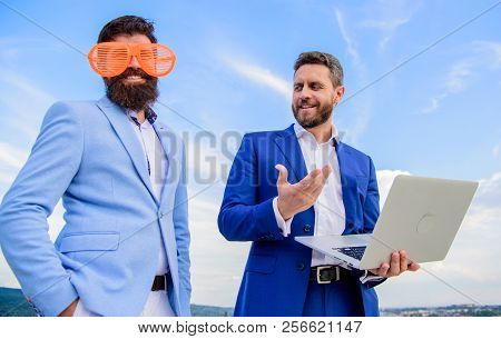 Ways To Get People To Take You Seriously. Businessman With Laptop Serious While Business Partner Rid