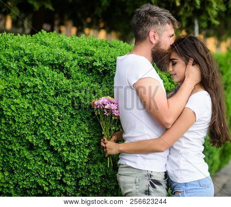 He Will Never Let Her Go. Couple In Love Hugs On Date In Park Green Bushes Background. Man Fall In L