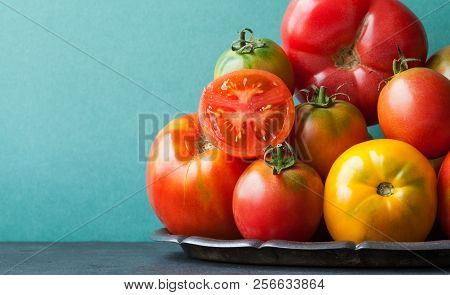 Close Up Fresh Organic Tomatoes On A Tray. Variety Tomato Vegetables, Different Size Red Yellow Pink
