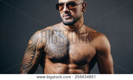 Confident And Handsome Brutal Man. Man Glasses. Stylish Sexy Man Looking Away. Handsome Brutal Man O