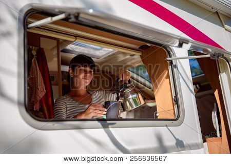 Woman cooking in camper, motorhome interior VR. Family vacation travel, holiday trip in motorhome, Caravan car Vacation.