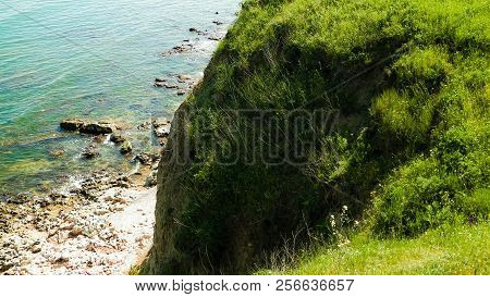 Green Grass On Cliffs On The Black Sea Coast. Landscape Of Cliffs And Beach In Vama Veche, Dobrogea