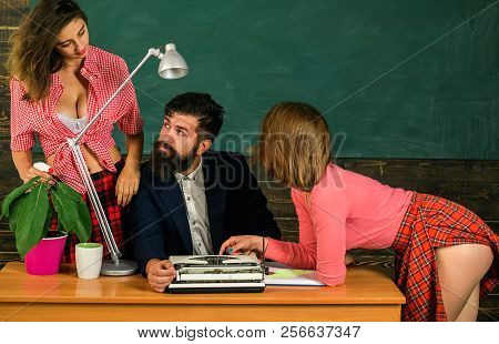 Bearded Sexology Teacher Looks At Two Sexy Female Students. Erotic Education And Sex Symbols On Chal