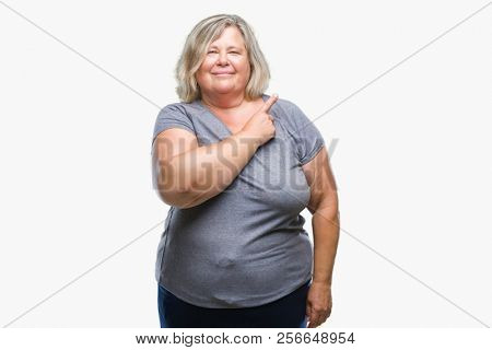 Senior plus size caucasian woman over isolated background cheerful with a smile of face pointing with hand and finger up to the side with happy and natural expression on face looking at the camera.