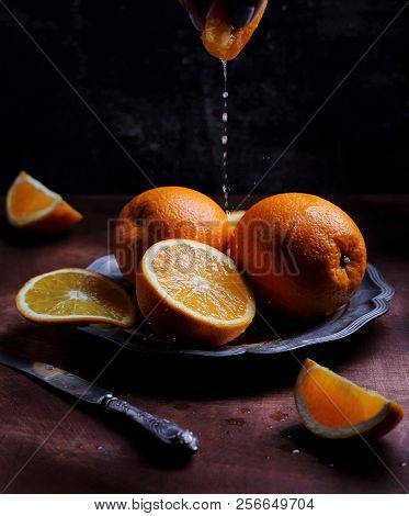 Oranges With Juice On A Silver Platter