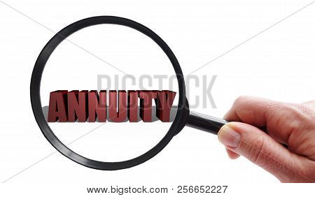 Magnifying Glass Looking At Annuity Text Over White -- Financial Investing Concept