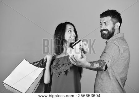Shopping And Leisure Concept. Man With Beard Holds Credit Card And Piggy Bank. Couple In Love Holds