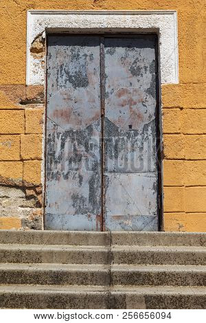 The Old Wooden Door. Ancient Antique Wooden In An Old Wall. Ancient Decorative Wooden Door. Historic