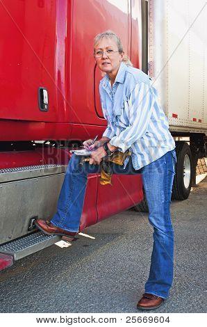 Pretty Woman Inspecting Truck