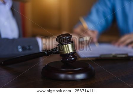 Judge Gavel On Wooden Teable Background With  Lawyer And Attorney Having A Meeting At A Law Firm.  C