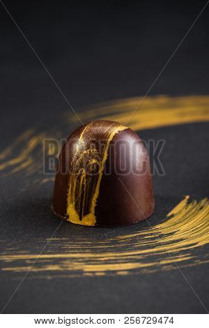 Luxury Bonbons Painted With Gold On Black Background. Exclusive Handmade Chocolate Candy. Product Co