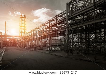 Pipeline And Pipe Rack Of Industrial Plant With Sunset Sky Background, Manufacturing Of Industrial P