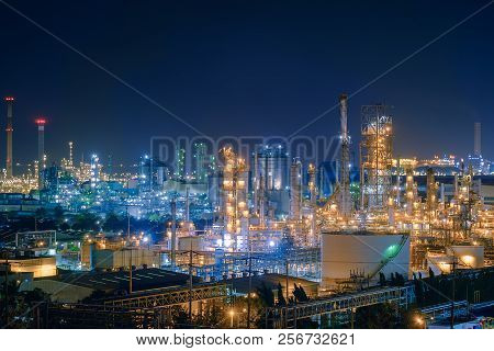 Oil And Gas Refinery Industry Plant With Glitter Lighting, Factory Of Petroleum Industrial At Night