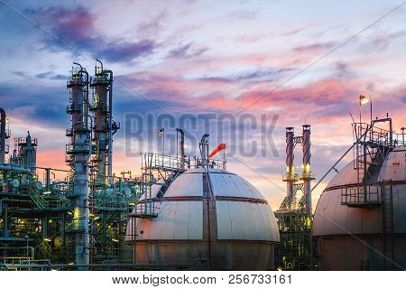 Petrochemical Plant On Sunset Sky Background With Gas Storage Sphere Tanks, Manufacturing Of Petrole