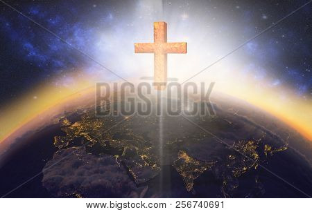 Cross Appearing On Planet Earth At Sunrise
