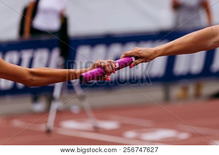 Women Team Relay Race Passing Of Baton On Stage