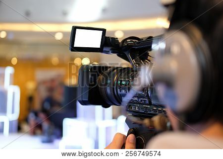 Video Production Camera Recording Live Event On Stage. Television Social Media Broadcasting Seminar