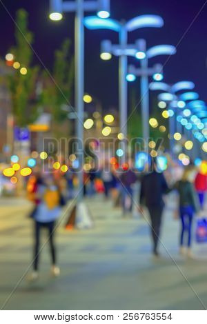 Abstract Bright Blurred Background With Bright Bokeh, City Street In Evening, Unidentified People, D
