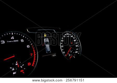 Close Up Shot Of A Speedometer In A Car. Car Dashboard. Dashboard Details With Indication Lamps.car