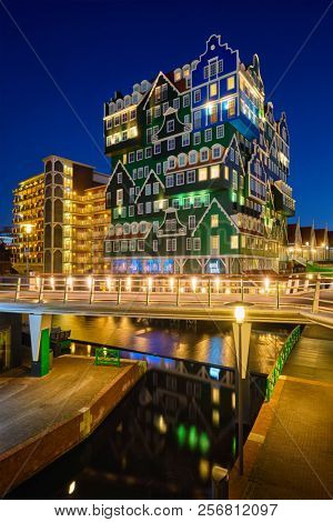 ZAANDAM, NETHERLANDS - MAY 8, 2017: Inntel Hotel in Zaandam illuminated at night. Design of 12-storey tall building opened in 2009 is the result of stacking a series of traditional Dutch houses