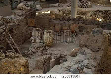 Vessels Spectacularly Preserved Within A Set Of Houses In The Archaeological Site Of Acrotiri. Arche
