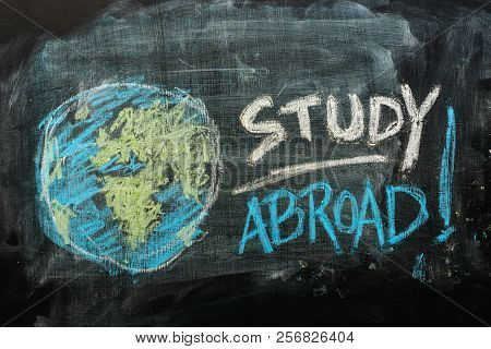 Study Abroad Concept With Handwritten Text In Chalk On School Blackboard