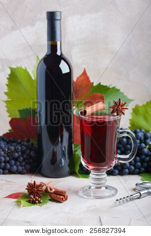 Bottle And Glass Of Red Mulled Wine Mockup For Your Logotype. Red Grapes, Spices Cinnamon, Anise, Cl