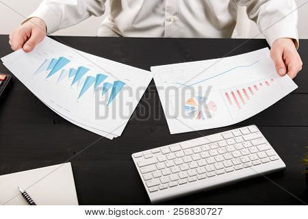 Close Up Of Man Accountant Or Banker Making Calculations. Close Up Of Man Accountant Or Banker Makin