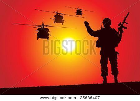 Soldat mit Hubschrauber auf dem Hintergrund