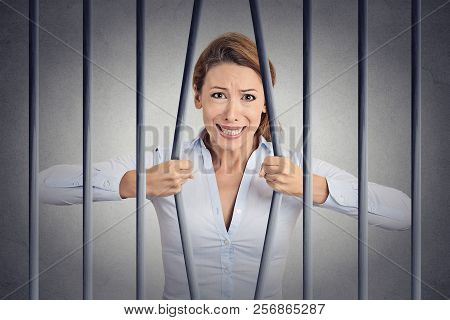Stressed Desperate Angry Businesswoman Bending Bars Of Her Prison Cell Grey Wall Background. Life Li