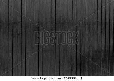 Black Wood Texture Background. Dark Wood Plank Abstract Background. Empty Black Wooden Wall. Wooden