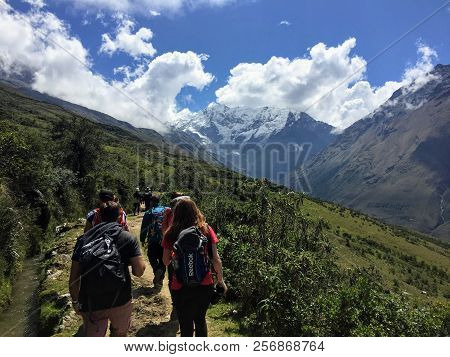 Cusco Province, Peru - May 8th, 2016: A Young Group Of International Hikers, Led By Their Local Inca