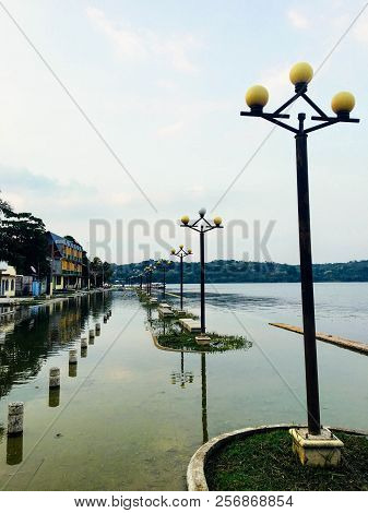 Flores, Guatemala - May 24th, 2018: The Boardwalk Of Flores, Guatemala Overrun By Rising Waters, Pot